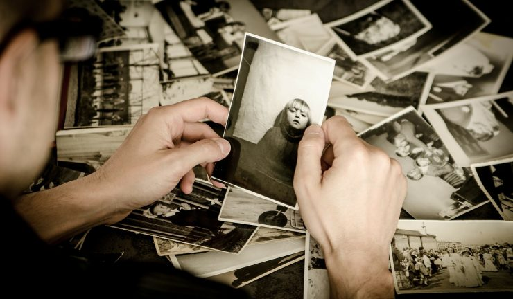 Person looks at old photographs
