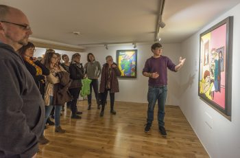 An artist giving a tour of the exhibition