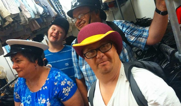 4 people with learning disabilities, wearing hats, in a theatre group