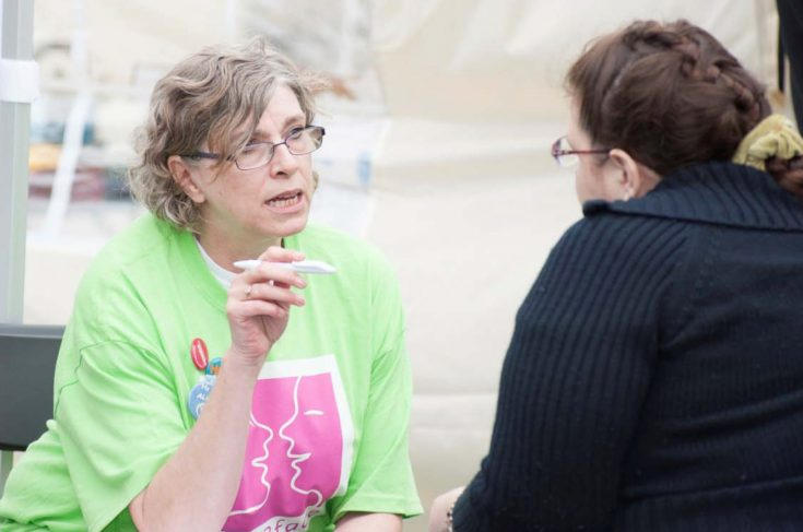 Face2Face volunteer having a conversation about mental health with member of public.