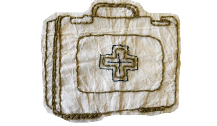 Fabric and embroidery artwork of a first aid kit
