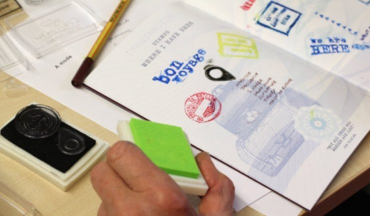 A person stamping a passport