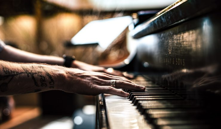 Close up of a person's hands playing the piano