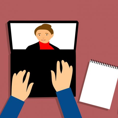 illustration of a person's hands typing on a laptop while a lady's face is on the screen.